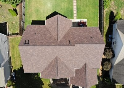 aerial drone shot of roof of a residential building