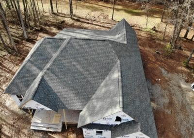 aerial view drone shot of residential home with siding work in progress